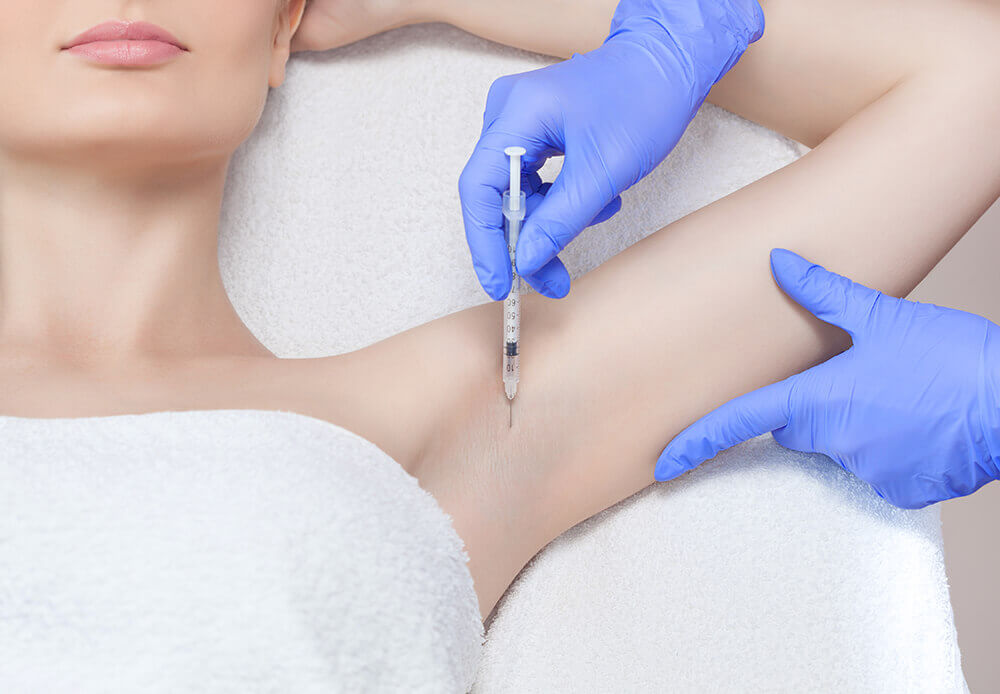 Woman receiving Botox injection in armpit