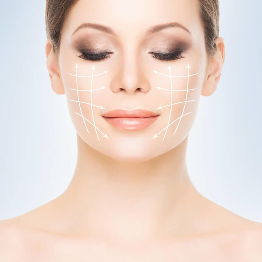 Woman's face marked with lines for laser treatment