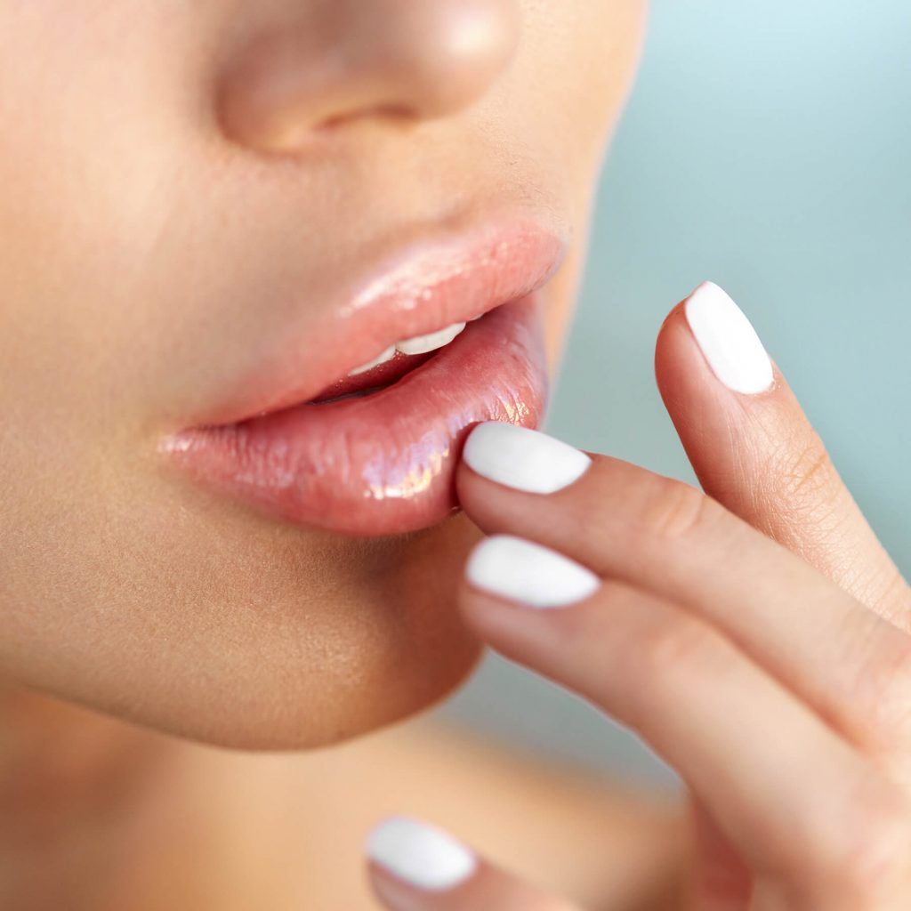 Woman applying lip trio treatment