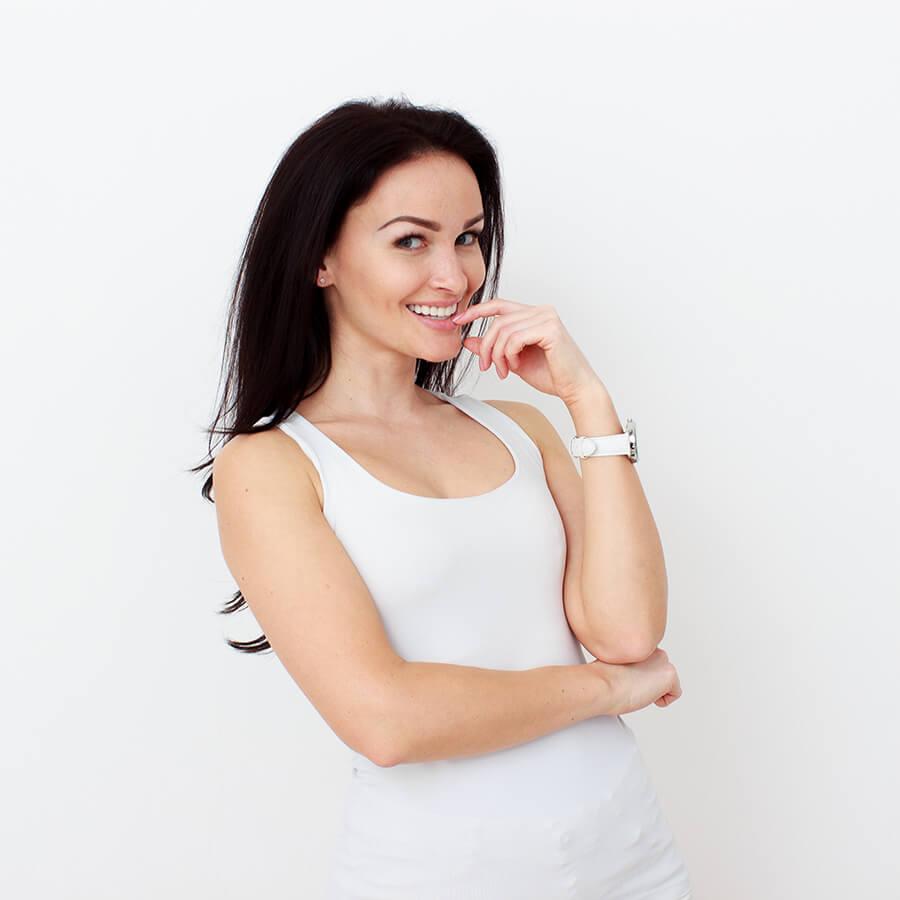 Smiling woman wearing white jumpsuit