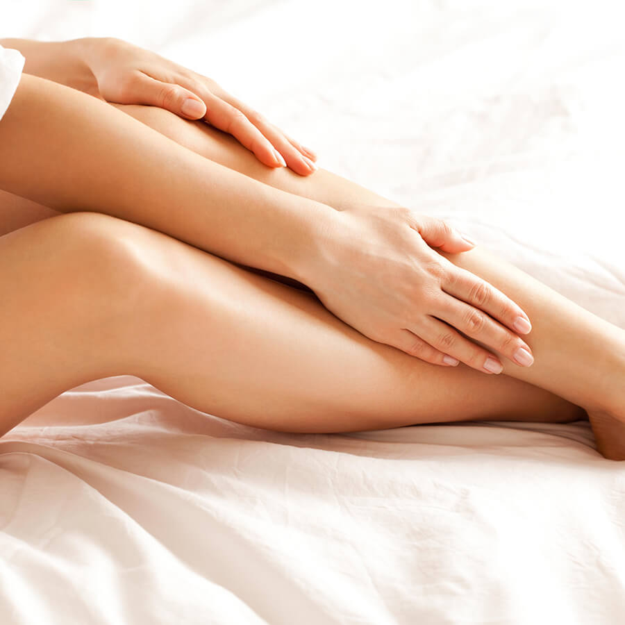 Woman caressing her perfect looking legs