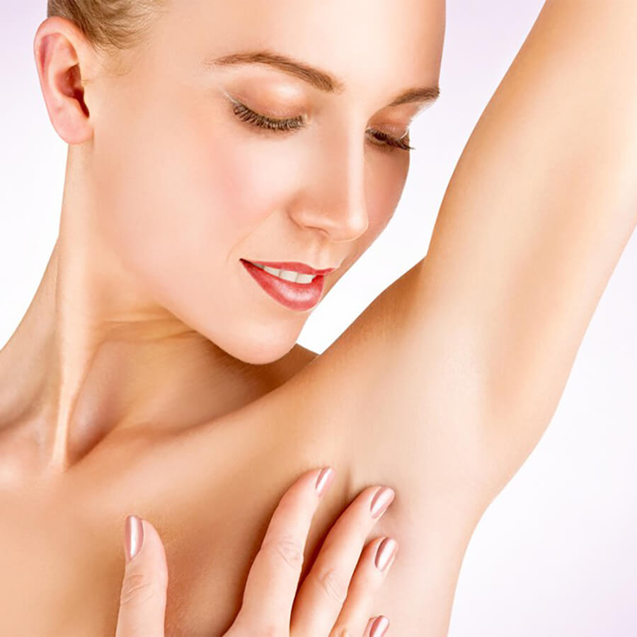Woman examining her underarm for hyperhidrosis
