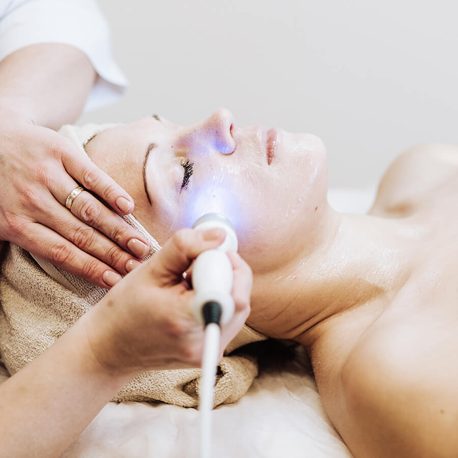 Woman getting ultrasound treatment on her face