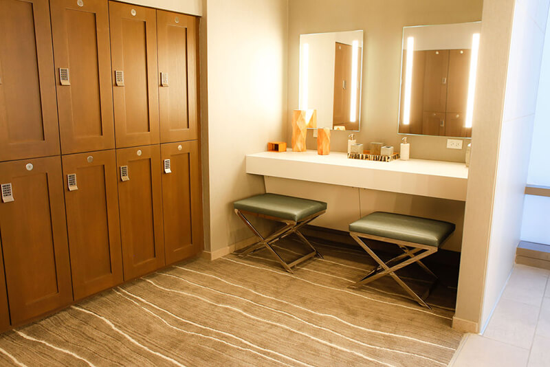 Emerge River Spirit mirrors on wall with counter and stools