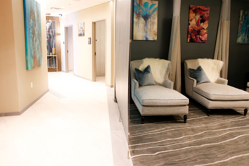 Emerge River Spirit room with lounge chairs and hallway