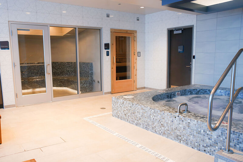 Emerge River Spirit hot tub room with spa rooms in the background