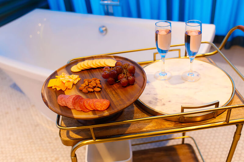 Emerge River Spirit treat tray with meats, nuts, crackers, cheese, and champagne