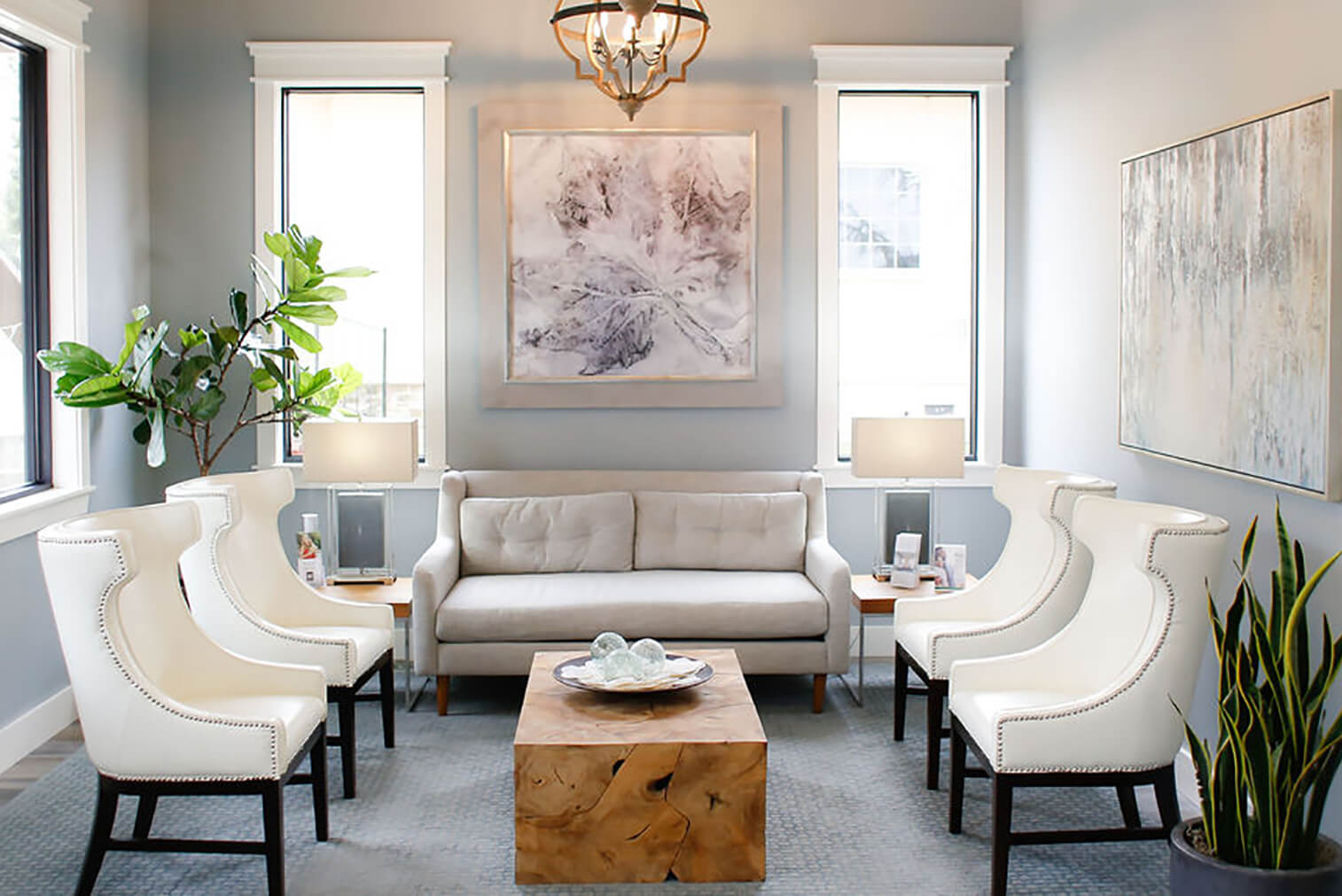 Emerge Midtown front entrance with chairs, loveseat, and table
