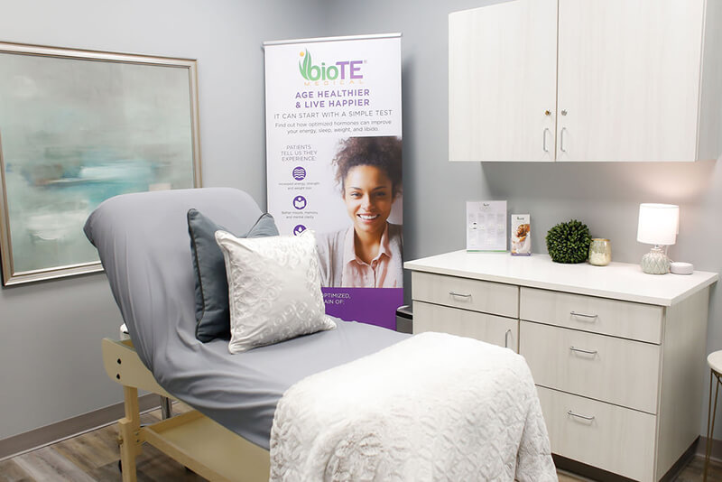 Emerge Midtown treatment room with bed and cabinets
