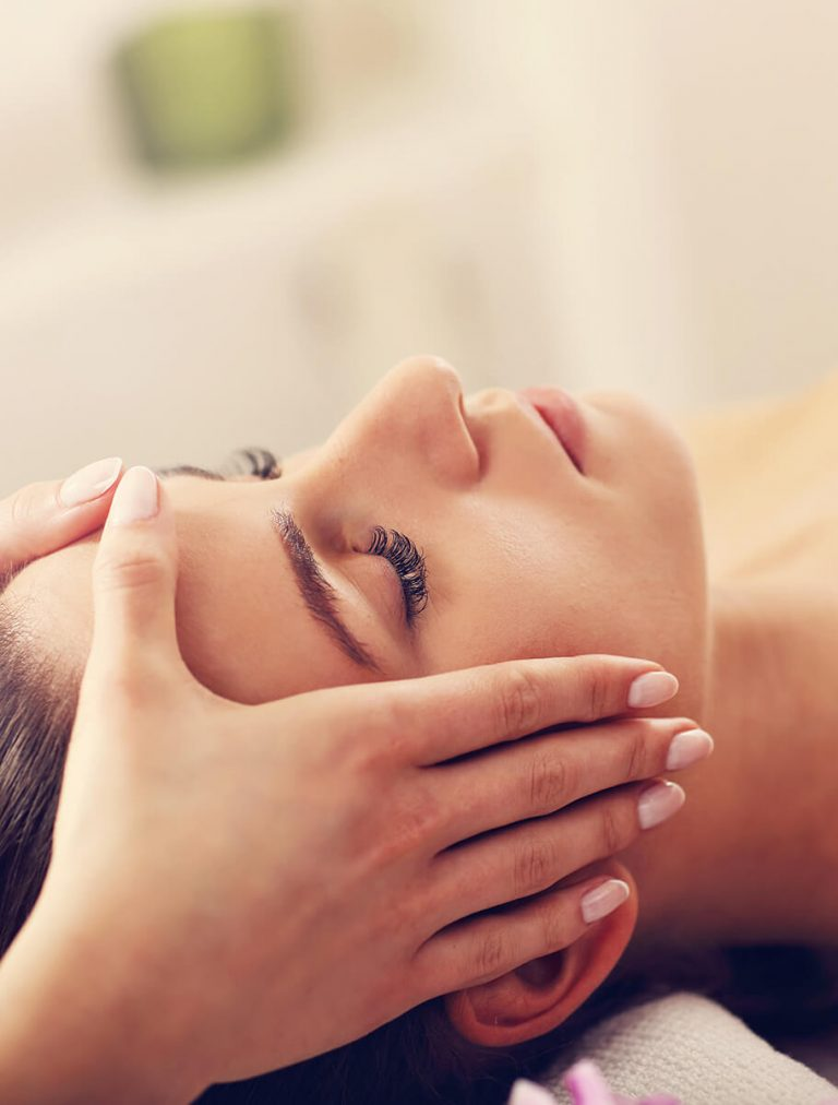 Woman getting a massage on her forehead
