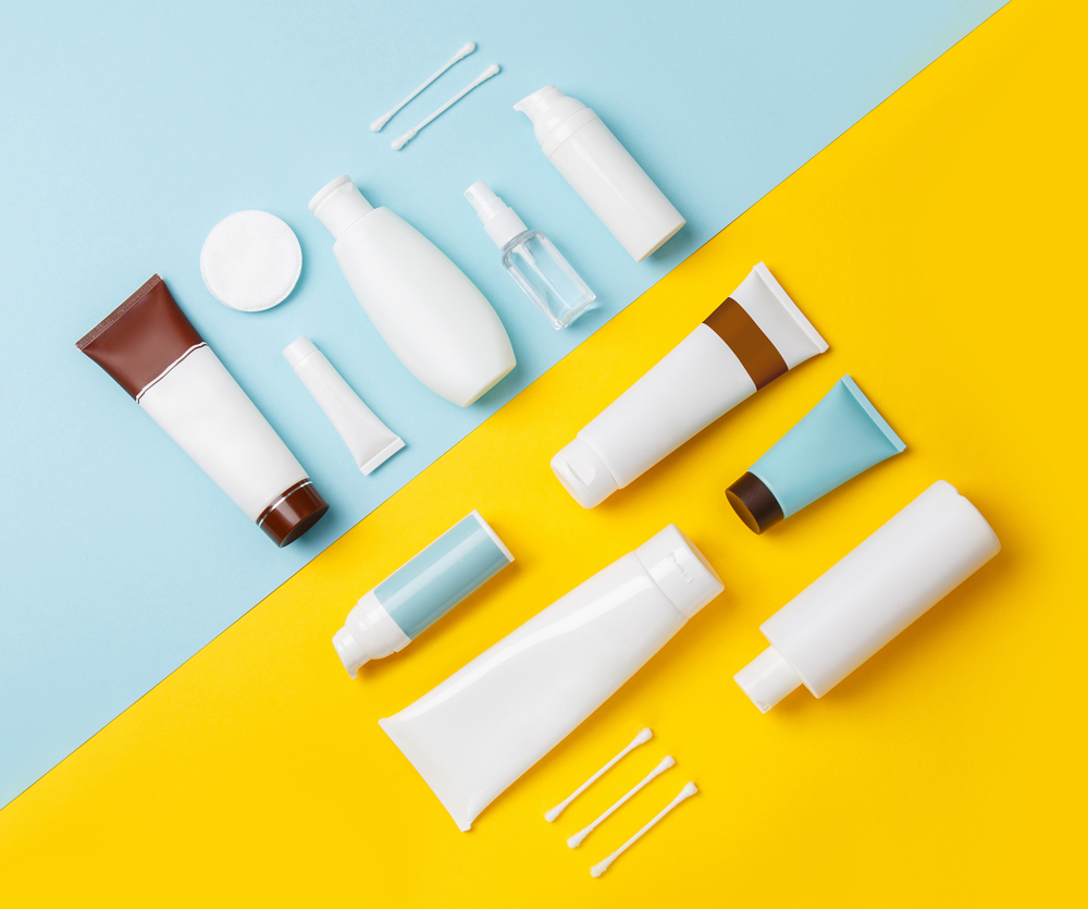 Skincare products in bottles on a blue and yellow background